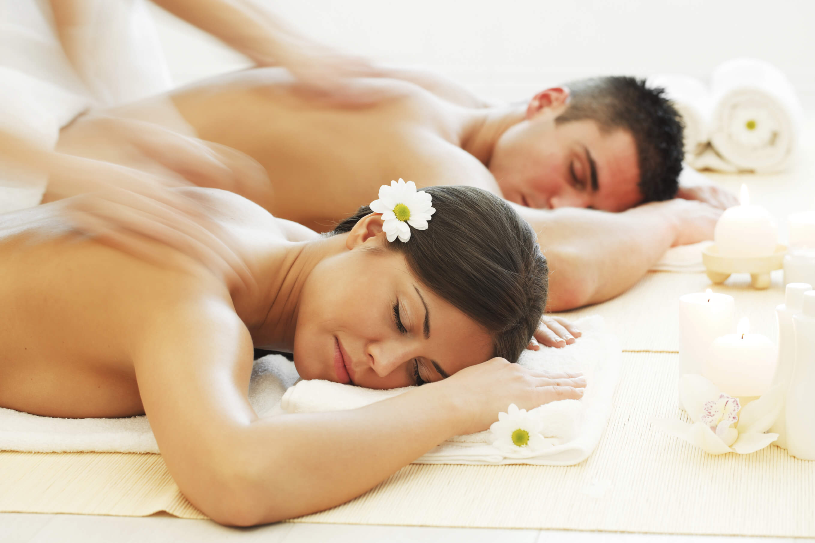 couples massage in white robes